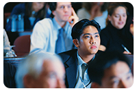 Image of a man listening intently during a class or lecture