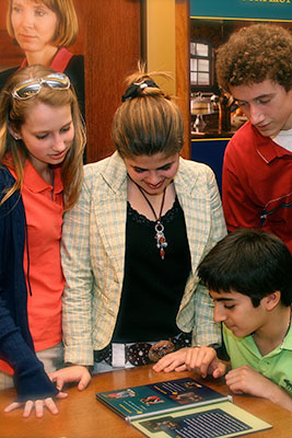 Image of a group of students interacting with an exhibit in the Visitor Education Center of the Thomas J. Moyer Ohio Judicial Center