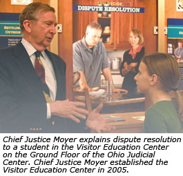 Chief Justice Moyer explains dispute resolution to a student in the Visitor Education Center on the Ground Floor of the Ohio Judicial Center. Chief Justice Moyer established the Visitor Education Center in 2005.