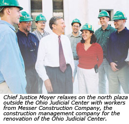 Chief Justice Moyer relaxes on the north plaza outside the Ohio Judicial Center with workers from Messer Construction Company, the construction management company for the renovation of the Ohio Judicial Center.