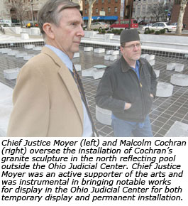 Chief Justice Moyer (left) and Malcolm Cochran (right) oversee the installation of Cochran's granite sculpture in the north reflecting pool outside the Ohio Judicial Center. Chief Justice Moyer was an active supporter of the arts and was instrumental in bringing notable works for display in the Ohio Judicial Center for both temporary display and permanent installation.