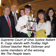 Supreme Court of Ohio Justice Robert R. Cupp stands with Findlay High School teacher Mark Dickman and some members of the winning We The People team.