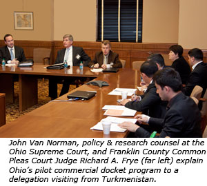 John Van Norman, policy & research counsel at the Ohio Supreme Court, and Franklin County Common Pleas Court Judge Richard A. Frye (far left) explain Ohio's pilot commercial docket program to a delegation visiting from Turkmenistan.