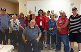 Ohio Supreme Court Justice Sharon L. Kennedy posting with a group of senior citizens at the Scenic Hills Senior Center