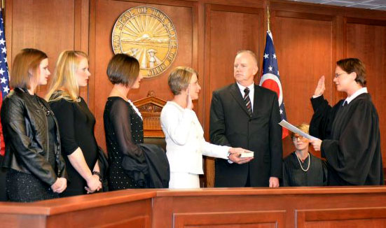 Image of Ohio Supreme Court Justice Sharon L. Kennedy administering the oath of office to Carol Ann Robb