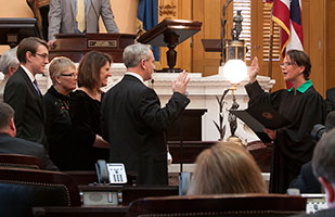 Image of Ohio Supreme Court Justice Sharon L. Kennedy administering the oath of office to members of the Ohio Senate