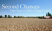 Image of a field of corn with a red farmhouse in the distance and the words 'Second Chances One Year in Ohio's Drug Courts' over a line of trees